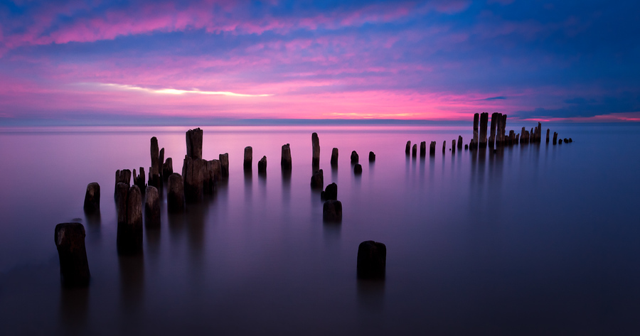I headed out this morning with Rick Seidel to shoot the sunrise at Grosse Point Lighthouse Park in Evanston. We got there just in time for the clouds to turn pink. We hoped that it would develop into a better sunrise, but it turned out we got the best light right when we got there. If you're looking for something a little different than the usual stuff around Chicago, this is a nice place to practice these types of shots.The Photographer's EphemerisI want to thank my parents, mother-in-law, brother-in-law, and my wife for all of the Apple gift cards for my birthdays and Christmas over the past year. I saved up enough of them for my first iPad and I am loving it.Last night before heading out, I tried an app called The Photographer's Ephemeris for the iPad. You can select any location in the world and it will show you the exact direction that the sun and moon will rise and set for any day of the year. You could use this to figure out where you would need to be standing to get the moon to rise directly over a given subject.For this morning's shoot, I learned that the sun would rise out over the lake (duh), but I can see this coming in handy in the future.Read more at www.outofchicago.com